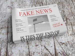 "A newspaper saying ""Fake news"" in the headline"