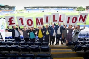 People holding £10m sign at the launch of the growth challenge