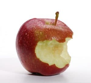 A red apple with a bite taken out of it, on a white background
